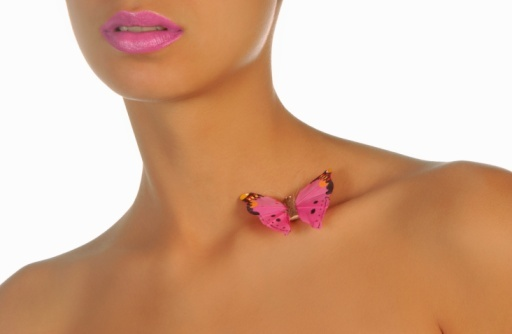 Woman with butterfly on her shoulder
