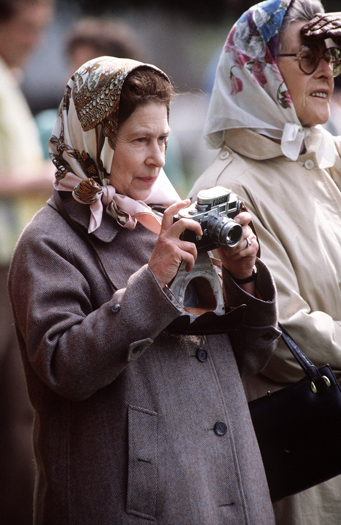 WINDSOR, UNITED KINGDOM - MAY 15: The Queen At The Windsor Horse Show Taking Photographs With Her Camera (Photo by Tim Graham/Getty Images)